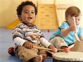 babies playing musical instruments