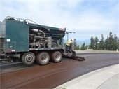 Truck completing slurry seal