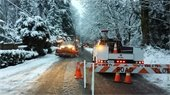 Snowplow and road closure on Norway Hill