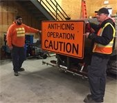 Crews with anti-icing operation