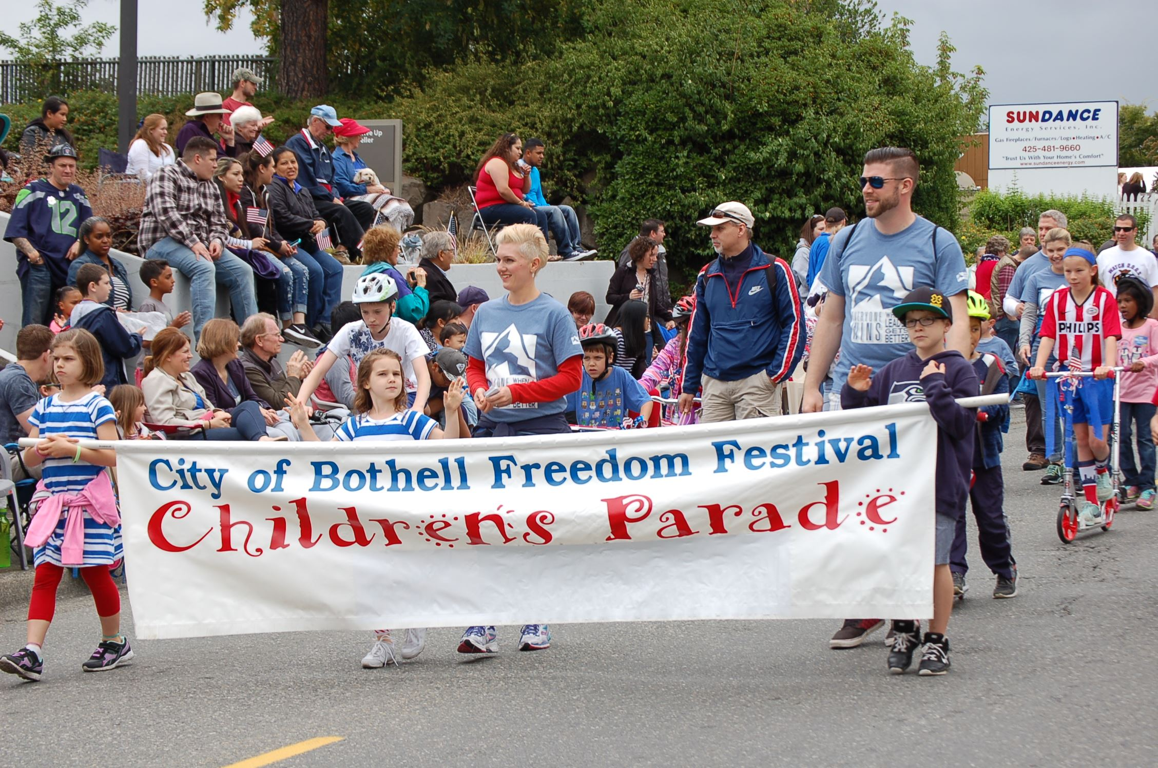 People walking with banner in Children's parade